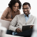 two people looking at computer